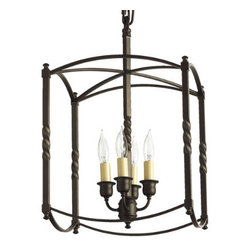 Carriage House Chandelier by Ballard Designs - I love this take on the classic carriage house chandelier, so much that I bought it in cream. It now lives in my TV room. It's the perfect addition to my otherwise modern space .