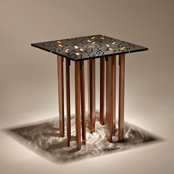 TIND End Table - The TIND End Table is a small, eco-friendly table with a strong visual presence.  The recycled steel top has been waterjet-cut with an intricate pattern that creates vivid light and shadow patterns.  The shapes of the bamboo legs are determined by the patterning in the steel top, and each of the fourteen legs passes through the steel top and then is cut flush.  Seen from above, the carbonized bamboo creates an arresting pattern that is juxtaposed against the other perforations in the steel.  Every table needs fourteen legs!