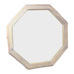 Kammika - Framed Teak Wood Mirror - Our Farmed Teak Wood Mirror Natural Edges Octagon 34 inch Diameter in Eco Friendly, Natural Livos Agate Grey Oil Finish is the classic Octagon shape with natural edges to the outside of the frame. The bias cut of the wood reveals the swirls of grain inside the branches from which they were cut. This eco friendly mirror presents with an extra large view size with true 5mm mirror glass. Even the mirror glass retainer bars are solid 1 inch Farmed Teak; there are no metal tabs. These can be used in outdoor spaces, as the natural oils create a water resistant surface. They are rubbed in Livos Agate Grey oil polished to a matte, water resistant finish. The oils are translucent, so the wood grain detail is highlighted, and makes the wood turn to an antique white look with a light grey patina finish. The light portions turn to shades of beige, and the dark lightens to shades of brown with a light transparent grey top coat over the white antique looking undercoat. There is no oily feel, and cannot bleed into carpets. Craftspeople from the Chiang Mai area in Northern Thailand create these pieces with the simplest of tools. Each is a unique creation, and as such is more than a piece of furniture - it is a Work of Functional Farmed Teak Wood Eco Friendly Art! We make minimal use of electric hand sanders in the finishing process. Dried in solar or propane kilns, no chemicals are used in the process, ever. After each piece is cut, dried, sanded, and rubbed with Livos oil, they are packaged with cartons from recycled cardboard with no plastic or other fillers. The color and grain of your piece of Nature will be unique, and may include small checks or cracks that occur when the wood is dried. Sizes are approximate. Products could have visible marks from tools used, patches from small repairs, knot holes, natural inclusions or holes. There may be various separations or cracks on your piece when it arrives. There may be some slight variation in size, color, texture, and finish color.Only listed product included.