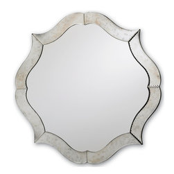Currey and Company - Monteleone Mirror - Like a perfectly still pond on a winter's day, you can lose yourself in reflection staring at this gorgeous silver mirror. Its unique curvy frame has antique charm, but all the polish of contemporary style. Hang it in the hallway, bathroom or anywhere you want to create a serene, peaceful atmosphere.