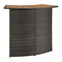 HomeStyles - Outdoor Woven Bar - An economical solution for upscale outdoor furniture. ready-to-assemble, synthetic resin wicker. This Riviera Outdoor Woven Bar is constructed of CycropleneTM, a synthetic resin wicker in a shade deep brown with a gold streak design, woven over rust-resistant, powder-coated aluminum frames. Top is constructed of shorea wood with a slat-style design. CycropleneTM is 100 percent recyclable, moisture and weather resistant, low maintenance material. Features include shaped-style bar and two interior shorea wood slatted shelves for storage. 52.5 in. W x 22 in. D x 42.5 in. H. Assembly required.