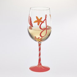 Frontgate - Seashell Hand-painted Wine/Martini Glass - Glasses are also signed by the artist on the bottom of the base. Hand wash. Personalized items are non-returnable. Keep beach season alive indefinitely with our personalized Seashell Hand Painted Glasses, available in both wine and martini glasses. Gentle pastels in intricate designs adorn your chosen glass, which is personalized with up to three initials on the bowl and up to 20 characters on the base. Packaged in a gift box tied with ribbon, it makes a perfect summertime gift.  .  .  . Made in the USA.