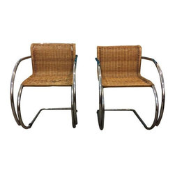 Pre-owned Rattan & Steel Chairs by Mies Van der Rohe - Striking chairs by Mies Van der Rohe. Tubular chrome and rattan with sweeping architectural arms and cantilevered seats. $360 for the pair!