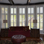 Elite Traditional Plantation Styles - This photo represents the beauty of our Elite Plantation Shutters featured in a family room. This group shows our unique 3'' shutter design with a high divider rail break separating the transoms above. Photo is courtesy of the Cusick Residence in Lakeside at Ansley.