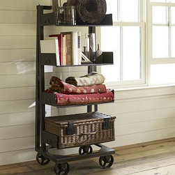 Harvey Bookcase | Pottery Barn - A cool industrial bookshelf.. Convenient on wheels too!