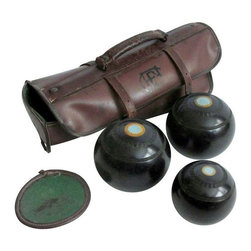 Used English Bocce Balls - Thomas Taylor Glasgow - A set of 3 English Lawn Bowls in their original leather case. Also known as Bocce Balls, the set is made by Thomas Taylor of Glasgow. The set is of three graduated sizes with a No. 2 1/4 bias. A yellow inset painted with a green center decorates the balls.    The set is estimated to be from the 40s and is made of Henselite, a form of Bakelite. The leather case is charmingly distressed. It shows signs of wear commensurate with age and use.    This set is perfect for a vintage sports display. The balls are excellent for decorative accents and provide a substantive, meaningful geometry. Or, put them to use, and give them a new life! Lawn bowling is still quite popular.