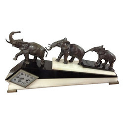 Consigned Art Deco Elephant Clock - Mantel clock with three elephants marching up the base. Clock face is diamond-shaped and the clock chimes and keeps time. Vintage 1910-1950. Excellent condition.