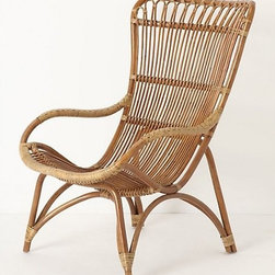 """Banda Armchair - Here's a laid-back spot for your porch or backyard. There's just enough of a tilt in the back to ensure you'll never want to get out of this armchair.Dimensions: 39""""H x 25""""W x 24""""D; seat is 15""""H. Made of rattan."""
