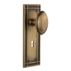 Nostalgic Warehouse - Nostalgic Mission Plate with Homestead Knob and Keyhole in Antique Brass - The Mission plate in antique brass harkens to the Spanish Colonial period of the Western frontier, with an instantly recognizable square corner. Add our Homestead Knob with its curvaceous oval shape for a look to enhance any home. All Nostalgic Warehouse knobs are mounted on a solid (not plated) forged brass base for durability and beauty.