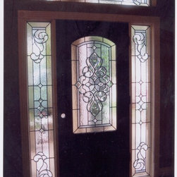 Custom art glass for the Entryway - Front door, Side lights, and transom done in a traditional design using obscure glass and bevels