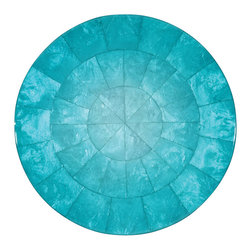 Kim Seybert Azure Ombre Capiz Placemat - Present your place settings like works of art, as fine chefs do in the world's most elegant restaurants, with the Capiz round placemat. A gorgeous designer base for elegant entertaining, these placemats are constructed from natural shell in all its beautiful variegations of hue and iridescence. A border of glossy demilune pieces provides a stylish decorative edge around a marbled center. Suitable for either round or rectangular tables, these placemats are sold individually.