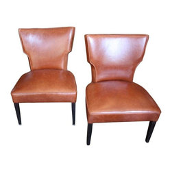 """1950s Leather Slipper Chairs - A Pair - These 1950s American Modern Slipper Chairs have been newly reupholstered in leather. The dark mahogany legs are original. The pair is in excellent, vintage condition. Seat height measures 16"""". Let these two accent chairs float in the corners of a dining room, then pull them up when the table is extended!"""