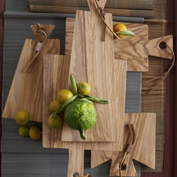 Olive Wood Cutting Boards - I like the idea of displaying food on these cheese boards instead of plates. The organic shape and wood finish are nice details.