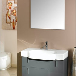 Iotti - 35 Inch Bathroom Vanity Set - Perfect for keeping things tidy with style, this vanity set has the space and contemporary looks to do just that. Available in finishes of Glossy White, Black and Gray, there's solid construction underneath for years of service. A wide fitted sink with overhanging basin leaves plenty of space for toiletries. Twin drawers and a door offer you generous storage space. The wall mounted mirror is lovely and resists scratches and corrosion. Imported from Italy. Set Includes: . Vanity Cabinet (2 drawers, 1 door). Fitted ceramic sink (35 inch x 17.7 inch ). Mirror (30.4 inch x 27.7 inch ). Vanity Light (11.8 inch ). Vanity Set Features:. Vanity cabinet made of engineered wood. Cabinet features waterproof panels. Available in Glossy Gray (as shown), Glossy Black, Glossy White. Cabinet features 2 soft-closing drawers, 1 door. Faucet not included. Perfect for modern bathrooms. Made and designed in Italy. Includes manufacturer 5 year warranty.
