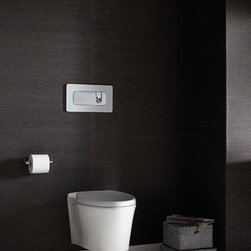 """Pléo Wall-Mount Toilet - From Greek meaning """"to float,"""" Pléo is a design that lifts elegant, modern form up off of the floor. Featuring a stylized, hourglass shaped bowl and a softly rounded actuator plate framed in smoky white glass, the Pléo wall-mounted toilet is a model of clean design. The dual-flush actuator buttons are intuitive to the touch with firm actuation. The bowl shape smoothly conforms to the wall in a straightforward approach and is proportionately scaled to fit any surrounding."""