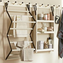 "Gabrielle Laundry Organizer Rail, Large, 37"", White - Smart and stylish, with a rail-and-peg system plus shelves and a drying rack, our collection elevates the usefulness and style of the laundry room. Because it's modular, it can be configured to suit various spaces and organizing needs. Drying Rack: 12"" wide x 22"" deep x 39"" high Shelf Unit: 17.5"" wide x 4.5"" deep x 36.5"" high Small Rail Peg: 22.75"" wide x 4"" deep x 3"" high Large Rail Peg: 39.75"" wide x 4"" deep x 3"" high Made of mango wood with a white painted finish. Blackened iron. Catalog / Internet only."