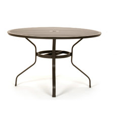Caluco - San Michelle Round Dining Table - The San Michelle Round Dining Table combines style, durability, and comfort to provide unmatched value in outdoor seating.  Pictured in the charcoal grey aluminum.