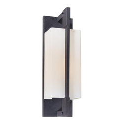 "Troy - Contemporary Blade Collection 15"" High Outdoor Wall Light - The Blade outdoor collection from Troy Lighting offers a sleek modern look. This attractive wall light is crafted from hand-worked wrought iron and comes in a forged iron finish. The fixture glows behind matte opal glass adding subtle softness to the geometric profile. A refined design that's perfect for illuminating your outdoor spaces. Hand-worked wrought iron construction. Forged iron finish. Matte opal glass. Takes one 100 watt bulb (not included). 15"" high. 4 1/2"" wide. Extends 5"" from the wall. 6"" from mounting point to top.  Hand-worked wrought iron construction.   Forged iron finish.   Design by Troy Lighting.  Matte opal glass.   Takes one 100 watt bulb (not included).   15"" high.   4 1/2"" wide.   Extends 5"" from the wall.   6"" from mounting point to top."