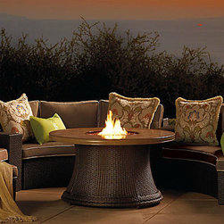 Melrose Fire Table - Fire pits evoke long, balmy summer evenings spent sitting and chatting with good friends. I like the curved design to this one.