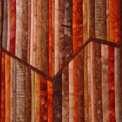 Fault Line Wall Art Quilt (Original) By Connie Betterley - The inspiration for the design of this wall art quilt came from a photograph showing layers of multi-colored sandstone and the shifts in the layers over time.  I selected a variety of batik fabrics to mimic the look and feel of stone without appearing cold.  This one-of-a-kind art quilt is crafted out of cotton batik fabrics and is delivered ready to hang in a special place in your home or office.