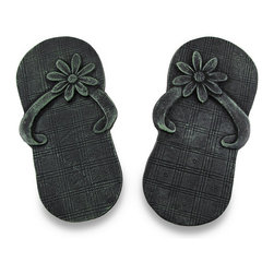 Cast Iron Verdigris Finish Flip Flop Stepping Stone Sandal - This cool flip-flop sandal stepping stone is designed to give your garden path a unique and delightful look. Made from cast iron, the flip-flop measures 12 1/4 inches long, 6 1/2 inches wide. They have an antiqued verdigris enamel finish that gives them an aged look. They make a great housewarming gift, and are perfect to add to new landscaping projects.
