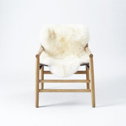 Leather + Fur Sling Chair - This cozy seat would be a great addition to my living room — except we would all want to claim it as our own!