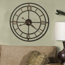 """Howard Miller - York Station Wall Clock - This antique style wrought iron wall clock is finished in aged iron with antique gold finished outer ring. Antique gold finished diamond shapes and Roman numerals mark the 12, 3, 6, and 9 hours. Features: -Antique gold hour and minute hands. -Quartz, battery operated movement. Dimensions: -21.25"""" Diameter x 1.75"""" D, 13.12 lbs."""