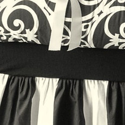 Black and White Crib Set - Skirt, Blanket and Bumper by Peaceful Dreams - I love how the stripes and swirls combine to make this crib bedding both classic and contemporary. This seller says you can add an accent color (pink, pink, pink), but I think I like it best as-is.