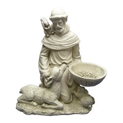 Design Toscano - Design Toscano St. Francis Feeds the Animals Garden Statue - EU40076 - Shop for Statues and Sculptures from Hayneedle.com! With the Design Toscano St. Francis Feeds the Animals Garden Statue gracing your yard all animals are sure to feel welcome. The attractive faux-stone finish brings out the elegant design of this resin statue.About Design ToscanoDesign Toscano is the country's premier source for statues and other historical and antique replicas which are available through the company's catalog and website. Design Toscano's founders Michael and Marilyn Stopka created Design Toscano in 1990. While on a trip to Paris the Stopkas first saw the marvelous carvings of gargoyles and water spouts at the Notre Dame Cathedral. Inspired by the beauty and mystery of these pieces they decided to introduce the world of medieval gargoyles to America in 1993. On a later trip to Albi France the Stopkas had the pleasure of being exposed to the world of Jacquard tapestries that they added quickly to the growing catalog. Since then the company's product line has grown to include Egyptian Medieval and other period pieces that are now among the current favorites of Design Toscano customers along with an extensive collection of garden fountains statuary authentic canvas replicas of oil painting masterpieces and other antique art reproductions. At Design Toscano attention to detail is important. Travel directly to the source for all historical replicas ensures brilliant design.