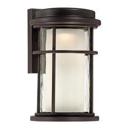 "Lamps Plus - Contemporary Park View Bronze 10 1/2"" High LED Outdoor Wall Light - This medium size oil-rubbed bronze LED outdoor wall light merges traditional design with modern energy efficient technology. Cylinder style fixture presents an oil-rubbed bronze finish housing and clear seedy glass. A frosted glass diffuser inside eliminates glare. LEDs can last up to 50000 hours so changing bulbs is practically a thing of the past. Oil-rubbed bronze finish. Clear seedy glass. Frosted glass diffuser. Includes four 4 watt LEDs. Color temperature is 3000K. Light output is 280 lumens. 10 1/2"" high. 6"" wide. Extends 7 1/2"".  Oil-rubbed bronze finish.   Clear seedy glass.   Frosted glass diffuser.   Includes four 4 watt LEDs.   Color temperature is 3000K.   Light output is 280 lumens.   Not dimmable.  10 1/2"" high.   6"" wide.   Extends 7 1/2"".  Back plate 5 7/8"" high x 4 3/8"" wide."