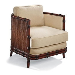 Frontgate - Wickham Club Chair - Generously proportioned comfort. The firm seat cushion is wrapped with 100% linen. Seat cushion is made of dense foam wrapped with plush polyfill. Wickham's generously scaled, barrel back design embraces a contrast of dark wood, woven fibers, and natural linen. Artisans carve the solid mahogany frame into convincingly realistic bamboo, and then give it a richly layered mahogany finish. The frame is wrapped with rattan peel that is handwoven into a striking herringbone pattern.  .  .  . Imported.
