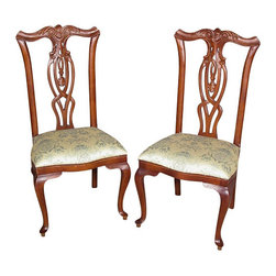 Pair of 2 Mahogany Queen Anne Floral Dining Side Chairs - This is a gorgeous pair of 2 mahogany Queen Anne style floral dining side chairs. Their backs have very attractive carved top rails with foliage and scrolls and they feature gorgeous pierced splats with distinguished curved designs. The chairs have comfortable seats upholstered with a beautiful sage fabric adorned with lovely floral & instrument designs. The cabriole legs exemplify elegance. Whether added to an existing piece of furniture or standing alone these chairs would be a lovely addition to any home. These chairs are showroom models and may have some minor imperfections but as shown they are overall in very good condition. They are shipped assembled.