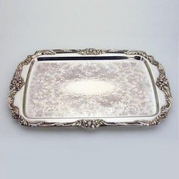 "Reed & Barton Rectangular Serving Tray - Reed & Barton's story began in 1824 when Isaac Babbitt created a new metal alloy - """"Britannia metal"""" - in his Taunton Massachusetts pewter shop. Babbitt joined forces with craftsmen Henry G. Reed and Charles E. Barton to produce this innovative higher-quality pewter ware. Reed & Barton offered to take control and began manufacturing products under their own names. The fledgling company's goods reflected uncompromising standards of excellence starting with its initial silver-plate products and extending to the exquisite sterling silver creations that resulted from the silver discoveries of the late 1800s.Today Reed & Barton is world-renowned for its vast array of high-quality sterling silver silver-plated and stainless flatware and giftware. The company's distinguished family of brands includes Reed & Barton Handcrafted Chests Miller Rogaska Crystal and R & B EveryDay. Reed & Barton is also the exclusive U.S. distributor of Belleek Fine Parian China and Aynsley Fine English Bone China Tableware. As one of the oldest privately held silversmith companies in the United States Reed & Barton remains steadfast in its commitment to fine design and superb craftsmanship."