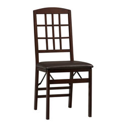Linon - Linon Triena Window Pane Back Folding Dining Chairs - Set of 2 - LHD1297 - Shop for Dining Chairs from Hayneedle.com! Bring home simple modern style and convenience with the Linon Triena Window Pane Back Folding Dining Chairs - Set of 2. When surprise guests show up for dinner just bring these two chairs out of storage. They snap open with ease to accommodate. Both feature a wood frame with window pan back and faux leather upholstery in deep brown finishes.About Linon Home DecorLinon Home Decor Products has established a reputation in the market for providing the best trend-right products at the right price while offering excellent quality style and functional furnishings to every room in the home. Linon offers a broad selection of furnishings for today's discriminating and demanding retail environments. They offer outstanding values for every room; a total commitment of quality service and value that is unsurpassed in their industry.Care/MaintenanceThe beauty of furniture care is that it helps to protect your investment. Fine furniture is an important purchase. Proper care will help maintain your furniture's finish and ensure that it looks great year after year. Caring for furniture is easy. Following a few simple guidelines will help extend the life of your furniture. Always dust with a polish-moistened cloth. Polish cushions the cloth eliminating the scratching that occurs with dry dusting. Dust will scratch the furniture surface if not removed properly. Use a soft clean cloth that won't scratch the surface. Avoid coarse or scratchy materials or fabrics. Never use soap and water on furniture. Water can penetrate the finish and raise the grain on wood causing damage. Many common problems in furniture care are caused by the elements. If you are aware of these troublemakers the resulting damage can easily be avoided. Sunlight's ultraviolet rays can damage wood finishes. Arrange furniture out of direct sunlight; use sun-screening drapes during intense sunligh