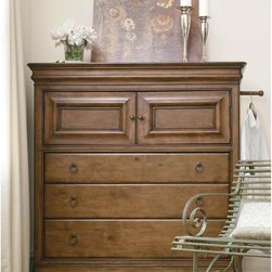 Pennsylvania House - New Lou 2-Door 3 Drawer Dressing Chest - Cognac - 071175 - Shop for Dressers from Hayneedle.com! The New Lou 2-Door 3 Drawer Dressing Chest Cognac reveals the lighter side of Louis Philippe style with a subtly updated design highlighted by solid alder wood construction in a lightly distressed cognac finish. This wonderfully versatile bedroom chest features a lifestyle-conscious mix of storage and features including a pull-out clothing rod on the side and a jewelry tray in the top interior tray drawer.This finely crafted chest makes 19th century style look charmingly fresh and contemporary with antiqued bronze ring hardware and inset panel doors that provide easy function and elegance. The top doors open on two tray drawers and an adjustable wooden shelf supported by three large drawers below for storage of clothing or linens. With side hidden drawers to complement its ample storage this New Lou chest will be your favorite furnishing secret.About Universal Furniture InternationalRecognized as a leader in exceptionally crafted home furnishings including bedroom and dining room items entertainment centers and more Universal strives to make items that are styled to endure but always remain fresh. They make it a goal to include features that fit the way their customers live today and to find prices that put high-quality products within reach. These are the principles that guide the work at Universal essential elements of good affordable and smart design.
