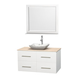 "Wyndham Collection - Centra 42"" White Single Vanity, Ivory Marble Top, White Carrera Marble Sink - Simplicity and elegance combine in the perfect lines of the Centra vanity by the Wyndham Collection. If cutting-edge contemporary design is your style then the Centra vanity is for you - modern, chic and built to last a lifetime. Available with green glass, pure white man-made stone, ivory marble or white carrera marble counters, with stunning vessel or undermount sink(s) and matching mirror(s). Featuring soft close door hinges, drawer glides, and meticulously finished with brushed chrome hardware. The attention to detail on this beautiful vanity is second to none."