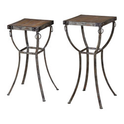 Uttermost - Hewson Plant Stands Set of 2 - Change your room and your outlook with these old world plant stands. The rustic metal pedestals are enhanced with natural wooden tops and rivets and iron rings. They can double as end tables in your home, studio or on the patio.