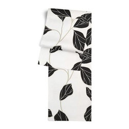 Black & White Modern Leaf Custom Table Runner - Get ready to dine in style with your new Simple Table Runner. With clean rolled edges and hundreds of fabrics to choose from, it's the perfect centerpiece to the well set table. We love it in this black and white leaf motif with graphic modern flare.