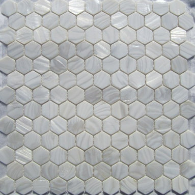 """White Mother of Pearl 1"""" Hexagons Tile - Mother of pearl tiles add new and unique elegance to your bathroom, backsplash, headboard, and more. Our Mother of Pearl tiles are handmade from genuine natural freshwater pearls. Although Mother of Pearl tiles are naturally thin, they are very strong and durable as well as easy to install in kitchens, bathrooms, and pools."""