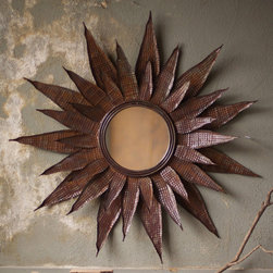 Giant Metal Flower Mirror - An exuberant sunflower made of handcrafted metal with a rusted iron finish. It's centerpiece? A mirror, reflect your good taste in the purchase of this fair trade cottage industry find. Thirty six inches in diameter.