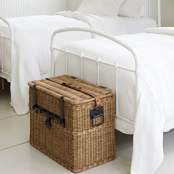 Ballard Designs - Travelers Wicker Chest - Small - Room enough for storing bulky bedding. Doubles as a coffee table. Rattan frame for strength. Antique honey finish. When we found the original, it was love at first sight. Our small Traveler's Wicker Chest is great for adding texture and storage at the foot of a bed or beside a sofa. Sturdy, hand woven wicker frame is accented with heavy, black metal latches and a buckled saddle leather strap.Wicker Chest features: . . . .