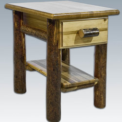 "Montana Woodworks - Glacier Country Nightstand with Drawer & Shelf - This handcrafted nightstand with drawer exemplifies just the right balance between aesthetics and utility. The Montana Woodworks artisans use solid American grown wood to create this sturdy heirloom quality table. The drawer measures 11.5"" W x 16.5"" D x 5.25"" H (inside measurements) and is ideally suited for holding the many small things found around the home. This nightstand is finished in the ""Glacier Country"" collection style for a unique, one-of-a-kind look reminiscent of the Grand Lodges of the Rockies, circa 1900. First we remove the outer bark while leaving the inner, cambium layer intact for texture and contrast. Then the finish is completed in an eight step professional spraying process that applies stain and lacquer for a beautiful, long lasting finish. Features mortise and tenon joinery. Comes fully assembled. 20-year limited warranty included. Hand Crafted in Montana U.S.A.; Solid, U.S. grown wood; Unique, one-of-a-kind Glacier Country style.; Heirloom Quality; 20 Year Limited Warranty; Durable Build, Fit and Finish; Each Piece Signed By The Artisan Who Makes It; Solid Wood, Edge Glued Panels; Easy Glide Drawer Slides. Dimensions: 20""W x 20""D x 25""H"