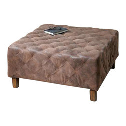 Uttermost Wetherly Quilted Ottoman - The time-worn feel of softened leather, captured in velvety polyester fabric, stitched and tucked into quilted comfort.  Wooden frame with weathered walnut legs. The time-worn feel of softened leather, captured in velvety polyester fabric, stitched and tucked into quilted comfort. Wooden frame features weathered walnut legs.