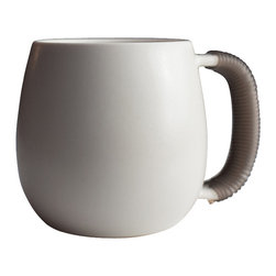 Pigeon Toe Ceramics - Bound Mug - This shapely hand-thrown porcelain mug, dipped in our satin white glaze 'bone' for just a hint of shimmer, is finished by wrapping the handle in a semi-translucent gray silicone rubber cord for a comfortable no-slip grip. Not only does it feel great to hold, it also washes easily, and adds a modern edge to an otherwise quiet shape.