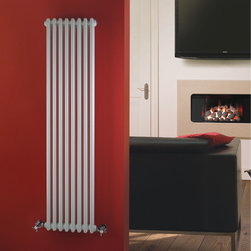 Hudson Reed - Traditional Column Vertical Radiator Heater Cast Iron Style White - This cast iron style radiator, with a high quality white powder coat finish (RAL 9016), has 8 vertical double columns that give a massive heat output of 1,216 Watts (4,146 BTUs) When combined with a set of modern valves, this up-to-date version of a classic radiator design is an ideal complement to contemporary settings, but also fits in well with traditional décor. This versatile radiator is compatible with all domestic central heating systems, will connect with your existing pipe work and is supplied complete with a wall mounting kit. For a truly authentic look, combine this traditional-style radiator with a Hudson Reed floor mounting kit (TRUSH017).  Traditional Column Radiator Cast Iron Style White 59 x 14 Details   Dimensions: (H x W x D) 59 (1500mm) x 15 (383mm) x 4 (100mm) Projection When Fitted: 4.5 (115mm) Output: 1,216 Watts (4,146 BTUs) Material: Steel Finish: White Powder Coat (RAL 9016) Columns: 8 x 2 Wall Mounting Brackets Included Please note: Angled Radiator Valves are required, please choose from the options above.  5 Year Guarantee on materials and finish Please Note: Our radiators are designed for forced circulation closed loop systems only. They are not compatible with open loop, gravity hot water or steam systems.