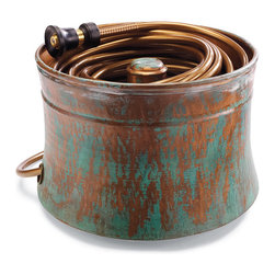 "Frontgate - Patina Copper Hose Pot - Large (20"" dia. x 15""H) - Constructed of 100% copper. Hand-applied patina finish will age beautifully over the years. Large size holds up to 150' of 5/8"" hose; Medium size holds 100' of 5/8"" hose. Drain holes prevent standing water. Exit hole for connecting hose to spigot. Our Patina Copper Hose Pot takes on the look of antiqued garden art, and becomes a beautiful way to store hoses out of sight. This pot's interior copper hose guide assures that your hose is wound without tangling. .  .  .  .  ."