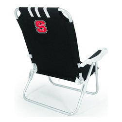 "Picnic Time - North Carolina State Monaco Beach Chair Black - The Monaco Beach Chair is the lightweight, portable chair that provides comfortable seating on the go. It features a 34"" reclining seat back with a 19.5"" seat, and sits 11"" off the ground. Made of durable polyester on an aluminum frame, the Monaco Beach Chair features six chair back positions and an integrated cup holder in the armrest. Convenient backpack straps free your hands so you can carry other items to your destination. Rest and relaxation come easy in the Monaco Beach Chair!; College Name: North Carolina State; Mascot: Wolfpack; Decoration: Digital Print"