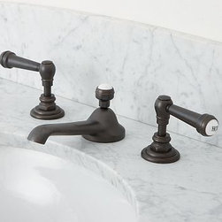 "Ashland Faucet, Antique Bronze finish - The incredible strength of die-cast brass makes the Ashland Faucet exceptionally durable and keeps it beautiful after years of daily use. Its graceful stepped base highlights its form, and multiple finish options allow you to create a consistent look throughout. Fits sink openings with an 8"" to 16"" widespread. A pre-installed aerator restricts water flow to 2 gallons per minute. Finished with ceramic buttons on the stopper and each lift rod. Each component is detailed with a hexagonal base. Professional installation required. {{link path='pages/popups/install_ashland_popup.html' class='popup' width='720' height='350'}}Learn more{{/link}} about how to install this faucet. View our {{link path='pages/popups/fb-bath.html' class='popup' width='480' height='300'}}Furniture Brochure{{/link}}."