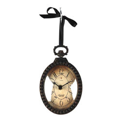 Kathy Kuo Home - Pocket Watch Style Vintage French Rustic Ribbon Vertical Oval Wall Clock - Evoke a sense of the old world with this incredibly eye-catching pocket watch style wall clock.  Made of antiqued iron with a rusty finish, this clock flaunts ornate iron detailing on the back, making it a great hanging clock on the wall or off. The glass-enclosed face of this clock features Roman numerals, an aged look and appropriately-styled clock hands, adding to the overall design.  Accompanied by a black ribbon for hanging, this battery-operated clock will keep today's time in the rustic or French-inspired interior.