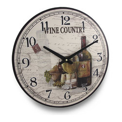 Zeckos - Round Wine Country Wine Themed Wall Clock 15 In. - Perfect for wine lovers, collectors and connoisseurs, this beautifully vivid 15 1/2 inch (39 cm) diameter pressed wood wall clock would look amazing in French or country themed kitchens, homes or even a wine cellar, and features a newly opened bottle of wine and a fresh glass poured surrounded by grapes and the Leaning Tower of Pisa in the background with the words 'Wine Country' at the top. It has large easy to see hands and visibly bold numbers to easily tell the time. The quartz movement runs on a single AA battery (not included). This clock would make a wonderful housewarming gift for a friend, and a gift that any wine drinker is sure to admire.